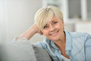 older woman blonde hair smiling